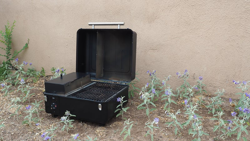 To achieve its compact design, Traeger moved the pellet hopper inside the grill body.