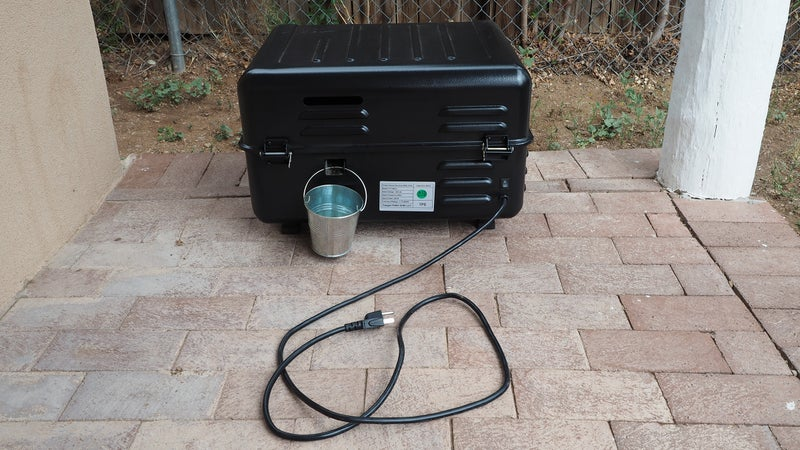 Smoke vents and a grease drip bucket are located on the back of the grill.
