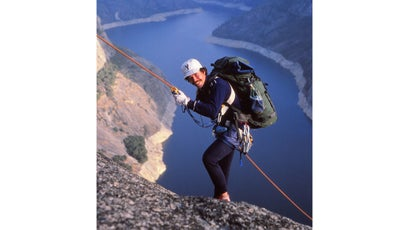 Rob Roy Ramey II rappels down into a peregrine nest above California's Hetch Hetchy reservior.