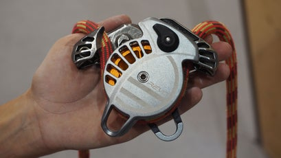 The Revo, open with a climbing rope threaded through the device.