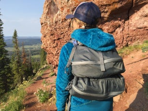 The author testing the REI Flash 45 and the Mystery Ranch Stein packs in Colorado.