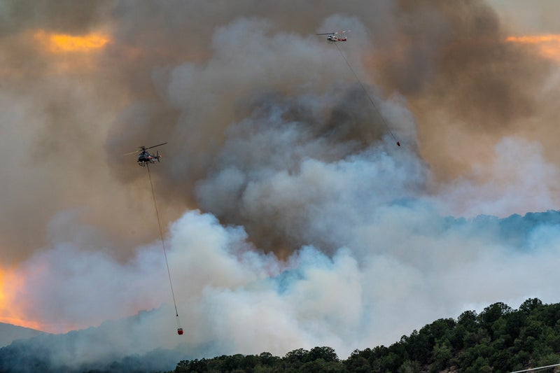"""July 3rd, 5:30 PM: A friend texts me that there is a """"fire close to your home."""" I race to Basalt and see billowing smoke from the nearby shooting range. Two helicopters are already working the fire dropping water via slurry pods from nearby Lake Christine.  We are amazed to learn that despite the level two fire restrictions (no fires, no fireworks, no nothing) our state-managed shooting range remained open despite calls to close from the town and the fire department."""