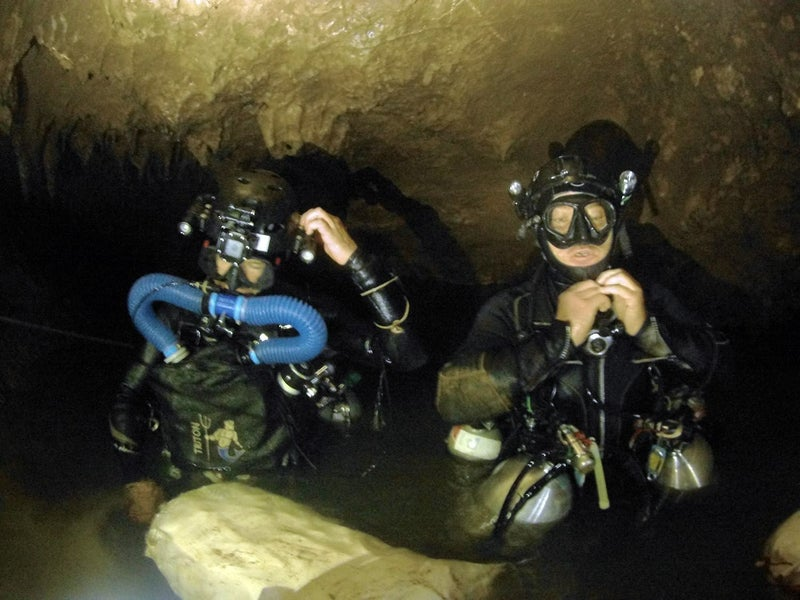 Divers preparing to descend in search of the soccer team's location.