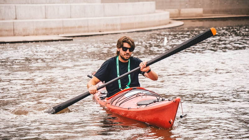 The author testing the Gearlab Aikak paddle at Outdoor Retailer Demo Day.