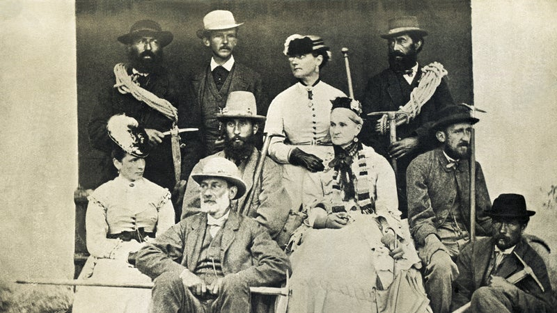 The Walker Family with friends and guides, 1870. Lucy Walker is in the back row, third from the left.