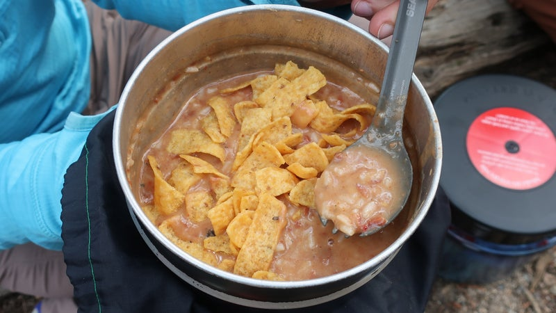 My favorite backpacking dish: beans & rice with Fritos and cheese. It does not go over as well at home, but it's a winner in the field.