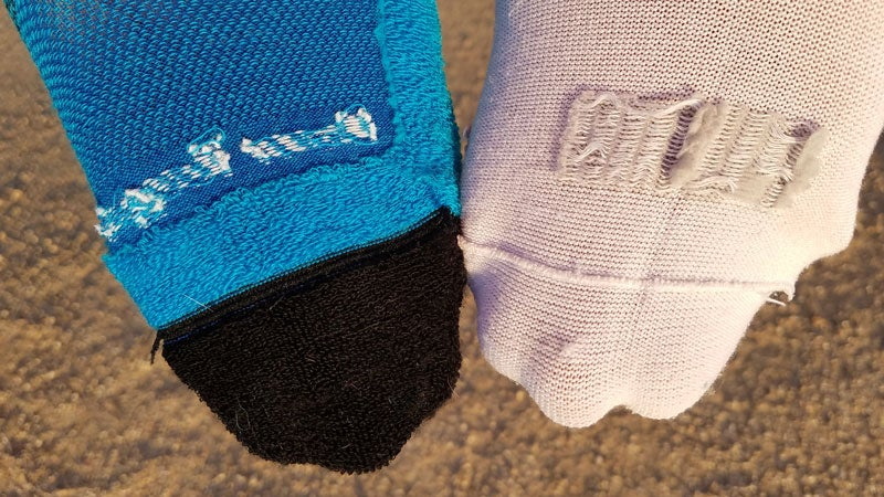 Showing the difference between a seamless link on the left and overlock seam on the right. The raised seam of the overlock can rub your toes causing hot spots.