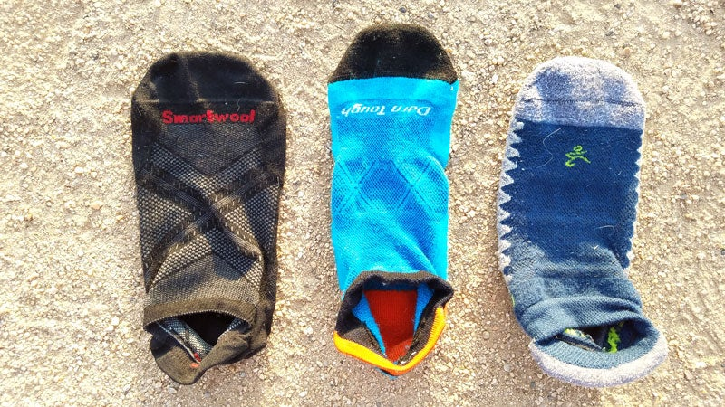 A comparison of the thinnest sock tested, the Smartwool Smartwool PhD Run Ultra Light (left) to the thickest sock, the Bagela Silver (right). The Darn Tough Vertex Ultra-Light Cushion pictured in the center falls just about the middle of the road.