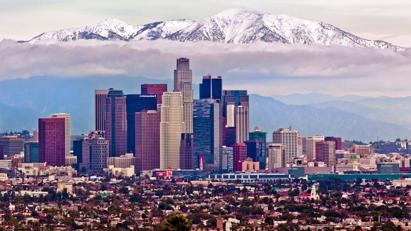 Yes, this is a real photo. The San Gabriels loom over downtown Los Angeles year round, and do accumulate enough snow most winters that you can actually ski them.