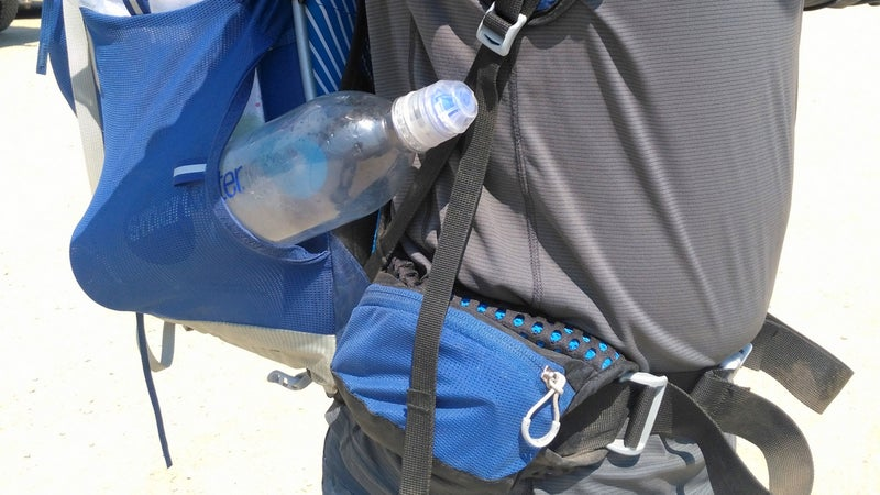 The previous-generation Exos had pockets on the hipbelt and shoulder straps. The new generation does not. Also note: To prevent your water bottle from sticking out annoyingly like in this photo, insert it cap first, then rotate the bottom of the bottle into the pocket.