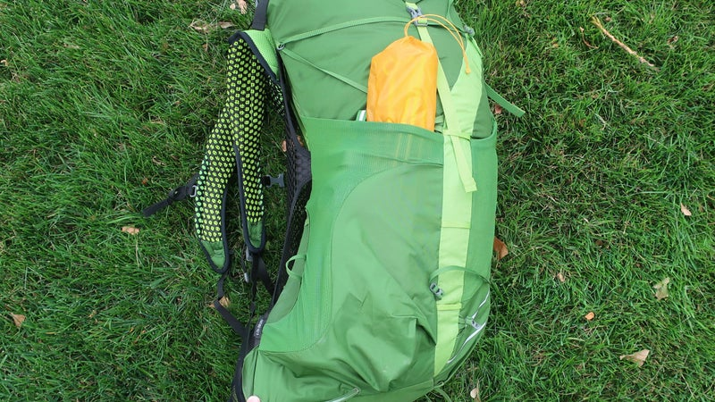 The side pockets are excellent: tall enough to hold everything secure (in this case, poles for a three-person tent and a one-liter Smartwater bottle) but accessible via the side entry.