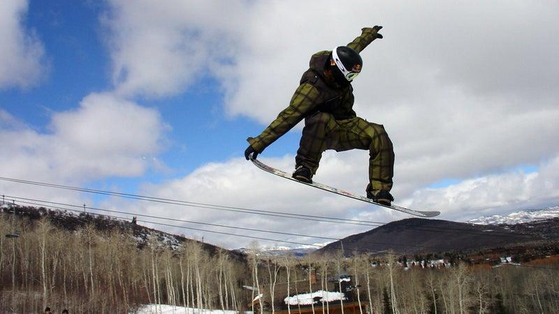 Shaun White snowboarding jump