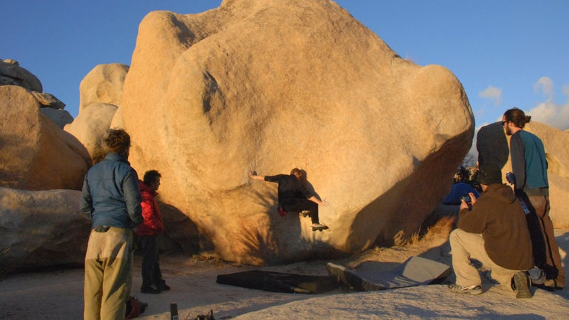 A climber bouldering in Joshua Tree.