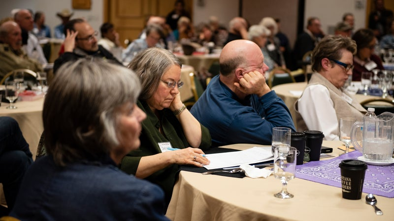 Attendees listen to Ammon Bundy's remarks at the New Code of the West event.