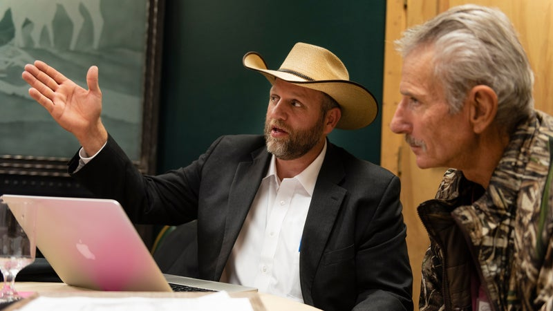 Ammon Bundy talks to a supporter at the New Code of the West conference.