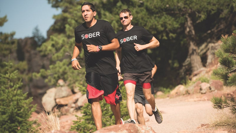 Two Phoenix members participate in a group run in Boulder last November