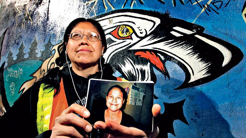 Audrey Auger-Keyesapamotoa with a photo of her missing daughter, Aielah