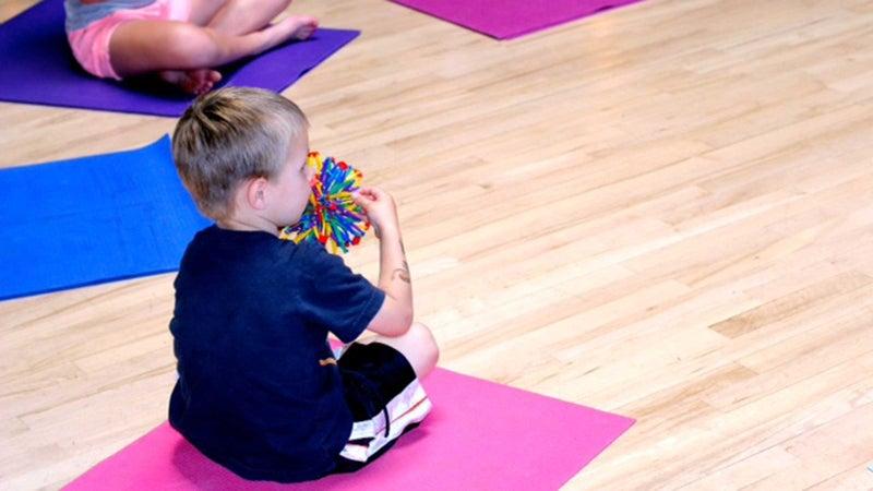 Yoga Calm's breath ball exercise teaches kids deep breathing.