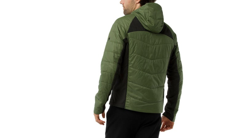 the black panels are bare, stretchy merino. They help the jacket fit closely, and maximize breathability.