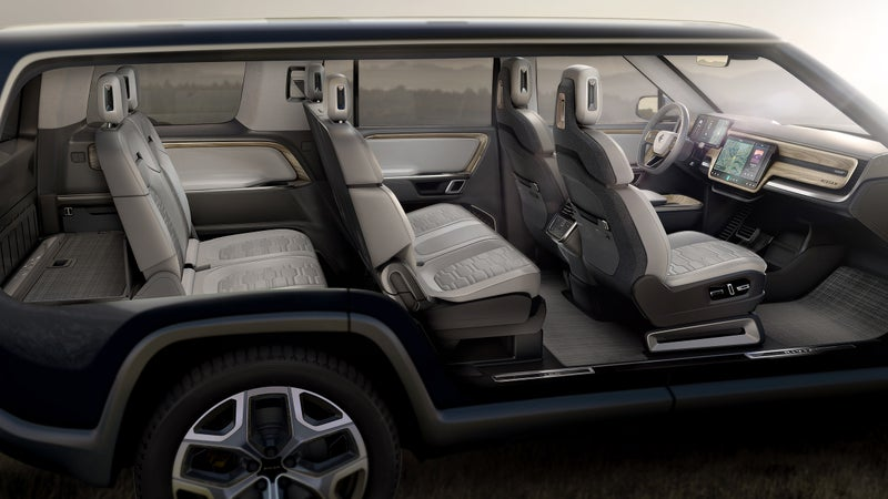 A cutaway showing the SUV's entire interior. Clean, minimal, lots of screens...this is very Tesla.