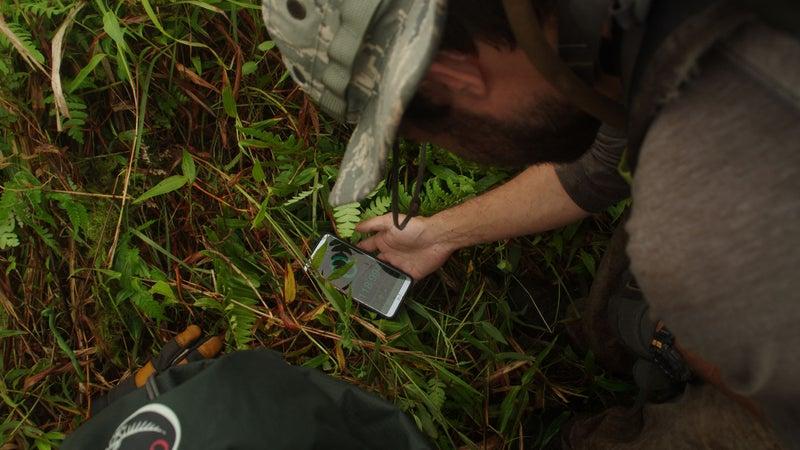 A climber checks the height of P952.