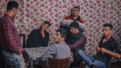 Kurdish men play dominos in Choman.
