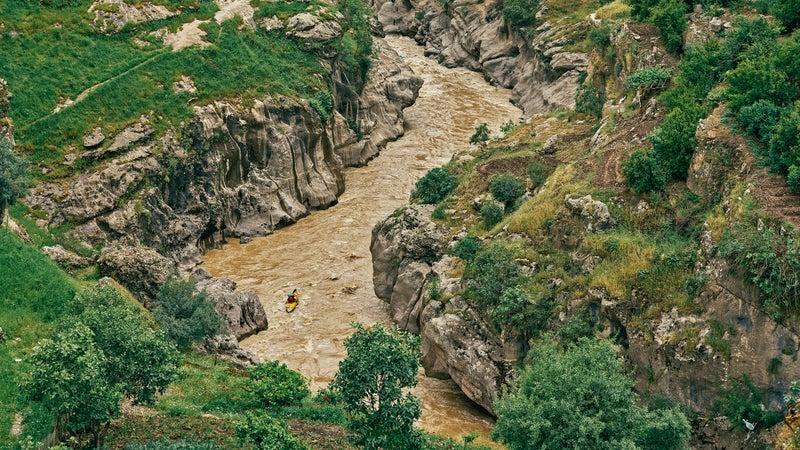 Environmental activist Nabil Musa runs a tributary of Iraq's Rawanduz River.