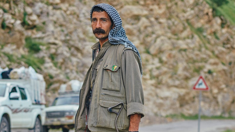 PKK guerilla Egid Serhad mans a checkpoint in Qandil.