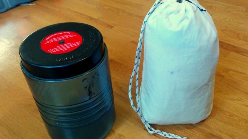 Two recommended food-storage options include hard-sided canisters like the BV500 (left) and soft-sided bear-resistant sacks like the Ursack Major (right).