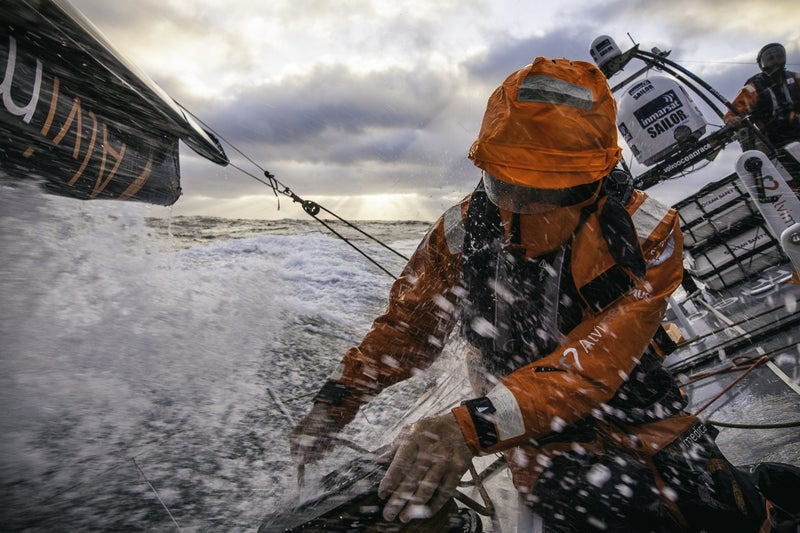 May 26, 2015, leg seven to Lisbon, Portugal, onboard Team Alvimedica. It's the ninth day, with 400 miles to the finish, and Abu Dhabi is breathing down its neck from the north, fighting for fourth position while the leading trio extends in strong winds. Dave Swete is easing the jib sheet, using a helmet to protect his eyes and face from incoming waves and water.