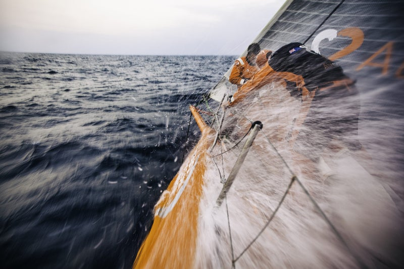 January 12, 2015: Leg three onboard Team Alvimedica. On day nine, nearing the inlet between Sri Lanka and India, winds accelerate through the gap, providing the fleet with a rare day of heavy-air sailing, a welcome change from the light winds that have dominated this leg. The bow team of Nick Dana and Dave Swete following a sail change.