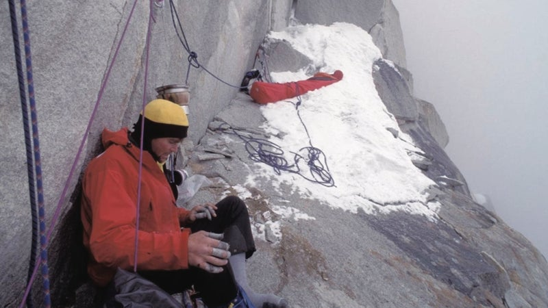 The final bivouac high on Great Trango Tower. The author discovered, shortly after taking this photo, that Lowe was badly injured from his fall and had spent the night sitting on the ledge without getting into his sleeping bag.