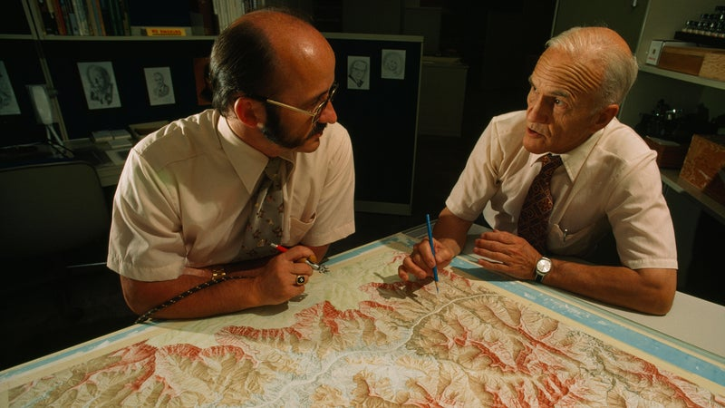 Washburn, right, discusses relief shading with National Geographic cartographer Tibor Tóth as they work on the Grand Canyon map. Washburn was involved with every aspect of the creation of the map.