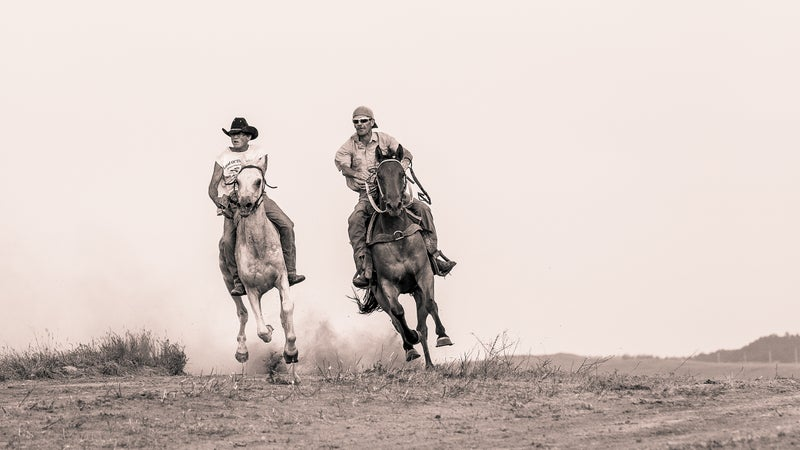 Stan Brewer Sr. (right) racing a friend