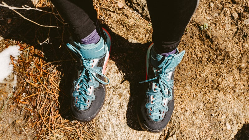 The author wearing her Hoka Sky Arkali boots in Boulder