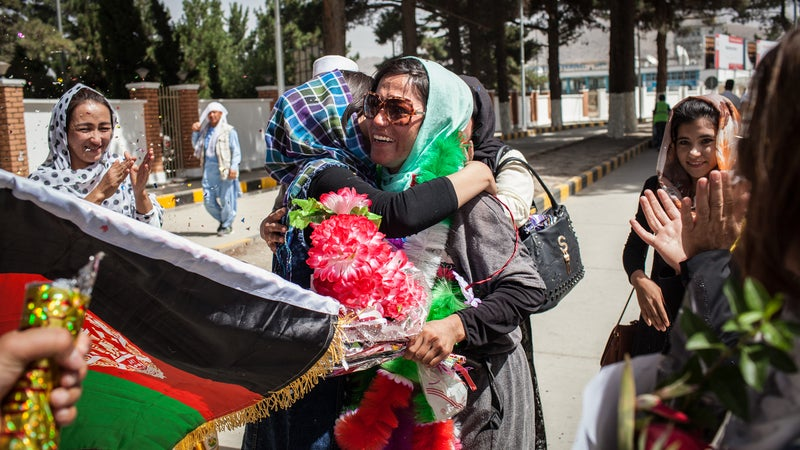 Yousoufi is greeted by family after the climb