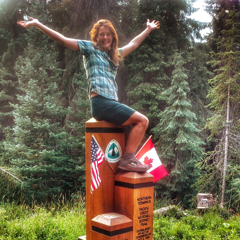 At the finish line, the US-Canada border at the terminus of the Pacific Crest Trail