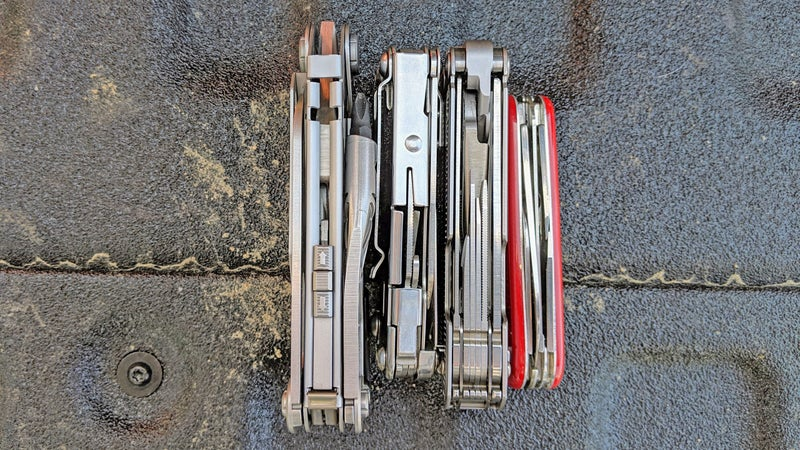 A comparison of thicknesses: (from left to right) the Gerber Center-Drive, the Leatherman Sidekick, the Leatherman Free P4, and the Swiss Army Spartan