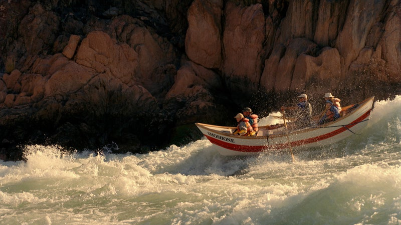 A Grand Canyon dory punching through Colorado River whitewater