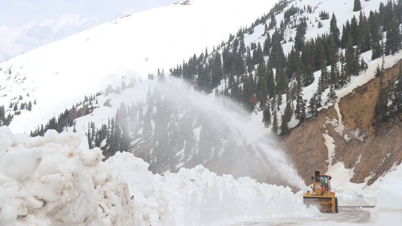 A snowblower works its way up the pass.