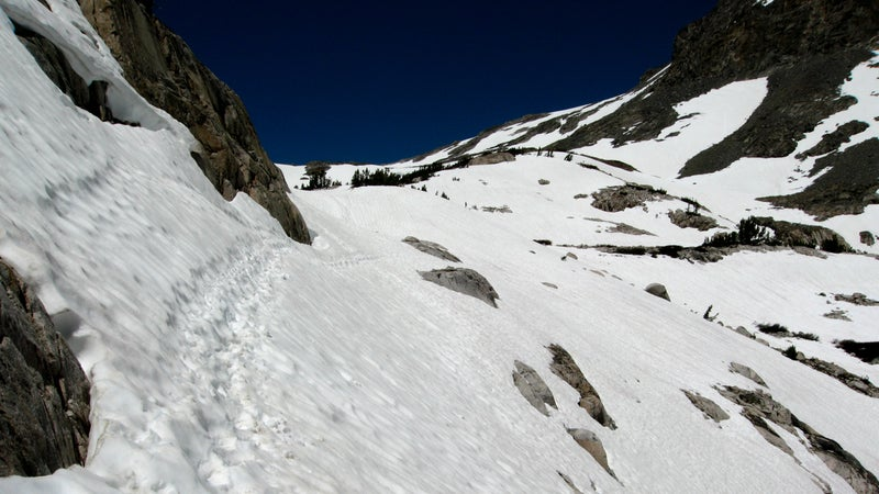 A boot track across a steep snowfield during the ascent to Muir Pass in late June of 2006