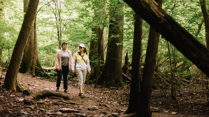 Adriana (left) in Eddie Bauer Resolution Tank Top, Guide Pro Pants, and Ventatrex Packable Jacket. Luz (right) in Eddie Bauer Momentum Light Jacket, Guide Pro Capris, and UPF Cap.