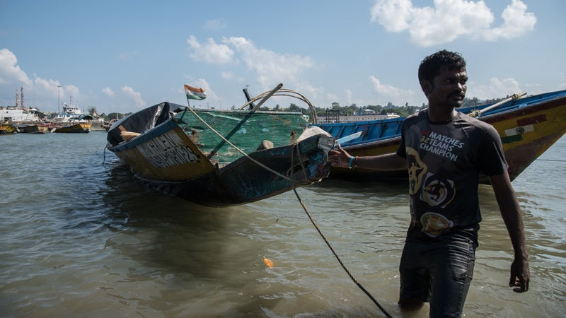 A fisherman pulls MV Halen, the boat Chau used to reach North Sentinel.