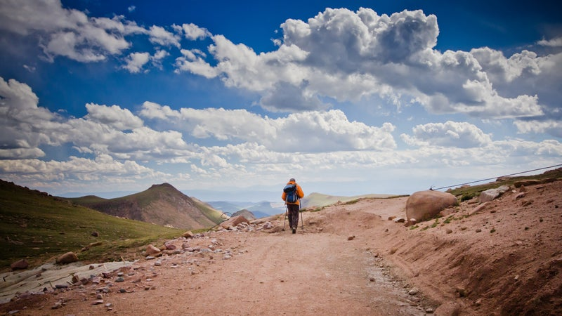 Man hiking in the mountain alone