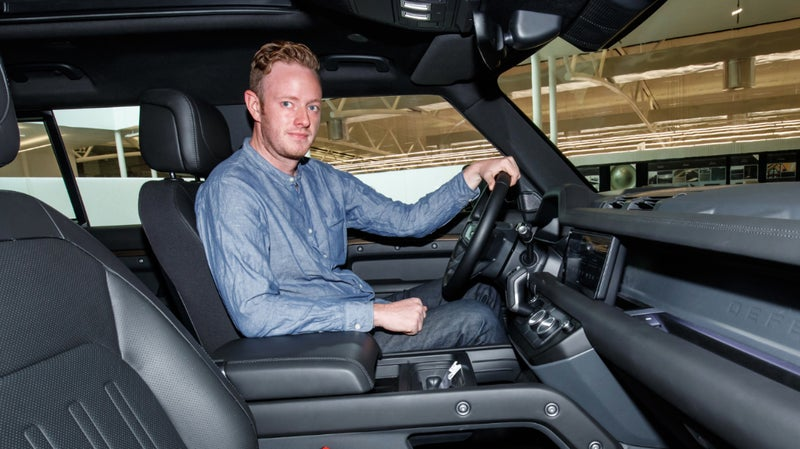 The author sitting in the new Defender, at the Land Rover Design Center, back in July.
