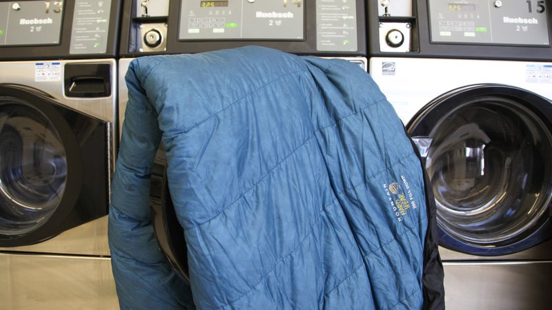 sleeping bag on the lid of a washing machine