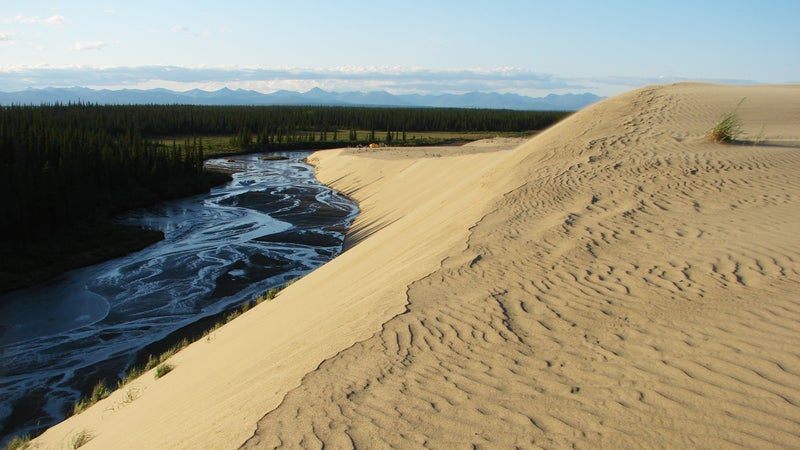 Ahnewetut Creek and nearby dunes glow in the setting sun.