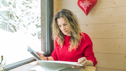 Sarah Marquis in her house, reading the notes she wrote while preparing her book, Wild By Nature