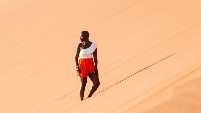 Nabongo climbing Namibia's sand dunes
