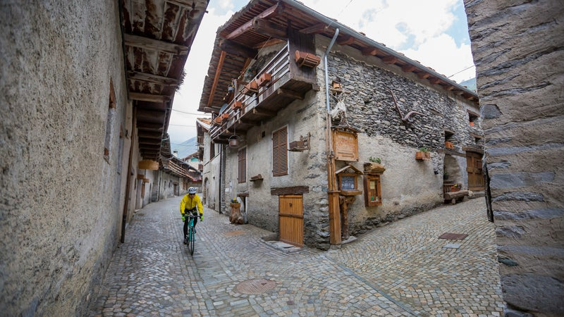 The descent from Colle dell'Agnello, which leads from France back into Italy, passes through quiet, cobbled Piedmontese mountain towns like Chianale.